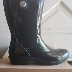 Gently used rain boots